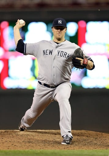 Jul 2, 2013; Minneapolis, MN, USA; New York Yankees starting pitcher Phil Hughes (65) delivers a pitch in the seventh inning against the New York Yankees at Target Field. The Yankees won 7-3. Mandatory Credit: Jesse Johnson-USA TODAY Sports