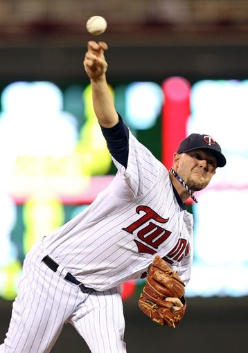 Jul 2, 2013; Minneapolis, MN, USA; Minnesota Twins relief pitcher Ryan Pressly (57) delivers a pitch in the eighth inning against the New York Yankees at Target Field. The Yankees won 7-3. Mandatory Credit: Jesse Johnson-USA TODAY Sports