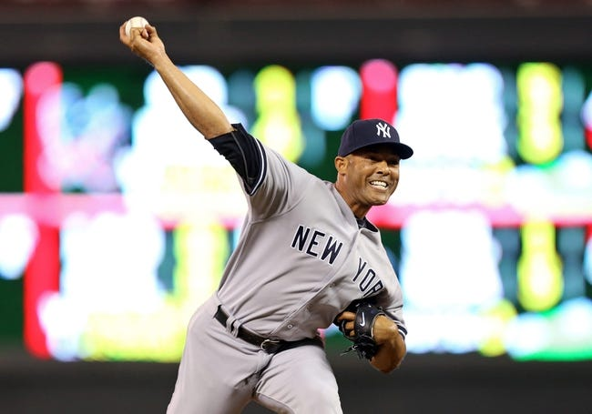 Jul 2, 2013; Minneapolis, MN, USA; New York Yankees relief pitcher Mariano Rivera (42) delivers a pitch in the ninth inning against the Minnesota Twins at Target Field. The Yankees won 7-3. Mandatory Credit: Jesse Johnson-USA TODAY Sports