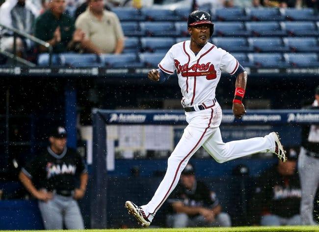 Jul 3, 2013; Atlanta, GA, USA; Atlanta Braves center fielder B.J. Upton (2) runs home to score on an RBI single by shortstop Andrelton Simmons (19) in the third inning against the Miami Marlins at Turner Field. Mandatory Credit: Daniel Shirey-USA TODAY Sports