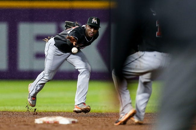 Jul 3, 2013; Atlanta, GA, USA; Miami Marlins shortstop Adeiny Hechavarria (3) flips the ball to second in the eighth inning against the Atlanta Braves at Turner Field. Mandatory Credit: Daniel Shirey-USA TODAY Sports