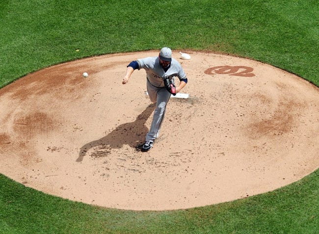 Jul 4, 2013; Washington, DC, USA; Milwaukee Brewers pitcher Donovan Hand (48) throws a pitch in the first inning against the Washington Nationals at Nationals Park. Mandatory Credit: Evan Habeeb-USA TODAY Sports