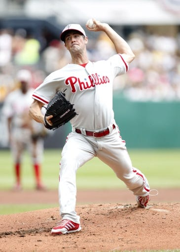 Jul 4, 2013; Pittsburgh, PA, USA; Philadelphia Phillies starting pitcher Cole Hamels (35) pitches against the Pittsburgh Pirates during the first inning at PNC Park. Mandatory Credit: Charles LeClaire-USA TODAY Sports