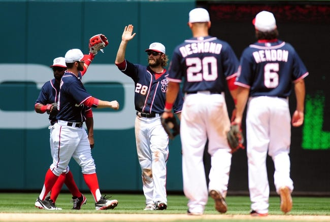 Jul 4, 2013; Washington, DC, USA; Washington Nationals outfielders Jayson Werth (28) and Bryce Harper (34) high five each other after beating the Milwaukee Brewers 8-5 at Nationals Park. Mandatory Credit: Evan Habeeb-USA TODAY Sports