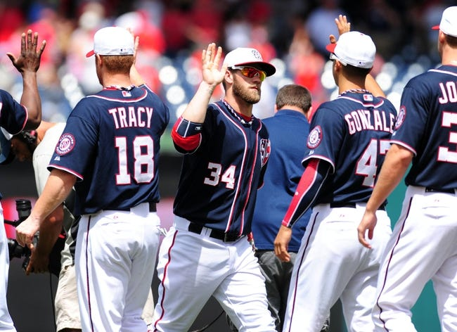 Jul 4, 2013; Washington, DC, USA; Washington Nationals outfielder Bryce Harper (34) high fives teammates after beating the Milwaukee Brewers 8-5 at Nationals Park. Mandatory Credit: Evan Habeeb-USA TODAY Sports