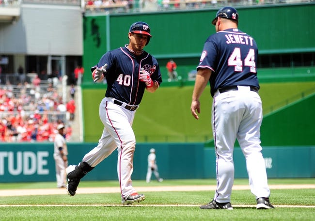 Jul 4, 2013; Washington, DC, USA; Washington Nationals catcher Wilson Ramos (40) high fives third base coach Trent Jewett (44) after hitting a home run in the eighth inning against the Milwaukee Brewers at Nationals Park. Mandatory Credit: Evan Habeeb-USA TODAY Sports