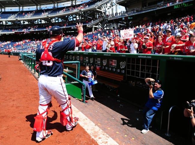 Jul 4, 2013; Washington, DC, USA; Washington Nationals catcher Wilson Ramos (40) waves to the crowd after beating the Milwaukee Brewers 8-5 at Nationals Park. Mandatory Credit: Evan Habeeb-USA TODAY Sports