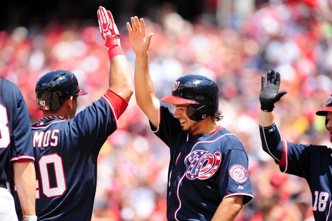 Jul 4, 2013; Washington, DC, USA; Washington Nationals catcher Wilson Ramos (left) high fives second baseman Anthony Rendon (right) after hitting a home run in the eighth inning against the Milwaukee Brewers at Nationals Park. Mandatory Credit: Evan Habeeb-USA TODAY Sports