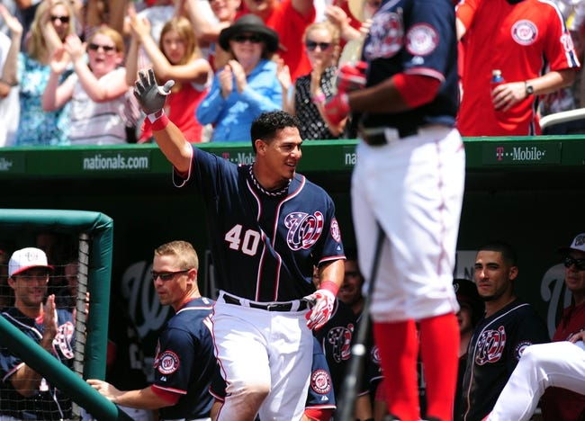 Jul 4, 2013; Washington, DC, USA; Washington Nationals catcher Wilson Ramos (40) takes a curtain call after hitting a home run in the eighth inning against the Milwaukee Brewers at Nationals Park. Mandatory Credit: Evan Habeeb-USA TODAY Sports