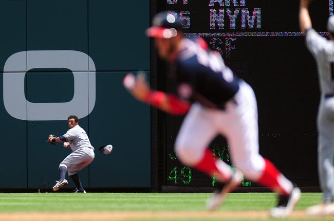 Jul 4, 2013; Washington, DC, USA; Milwaukee Brewers outfielder Carlos Gomez (27) throws the ball in after catching a fly ball in the third inning against the Washington Nationals at Nationals Park. Mandatory Credit: Evan Habeeb-USA TODAY Sports