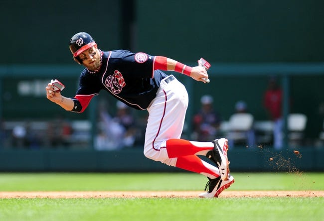 Jul 4, 2013; Washington, DC, USA; Washington Nationals outfielder Bryce Harper (34) steals second base in the third inning against the Milwaukee Brewers at Nationals Park. Mandatory Credit: Evan Habeeb-USA TODAY Sports