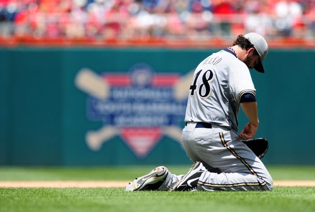 Jul 4, 2013; Washington, DC, USA; Milwaukee Brewers pitcher Donovan Hand (48) reacts after a runner reaches base by an error in the third inning against the Washington Nationals at Nationals Park. Mandatory Credit: Evan Habeeb-USA TODAY Sports