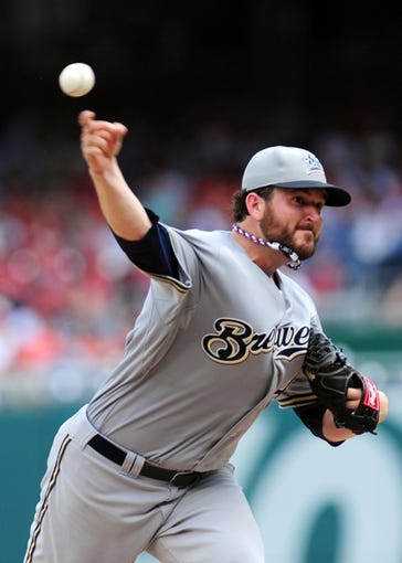 Jul 4, 2013; Washington, DC, USA; Milwaukee Brewers pitcher Donovan Hand (48) throws a pitch in the fourth inning against the Washington Nationals at Nationals Park. Mandatory Credit: Evan Habeeb-USA TODAY Sports