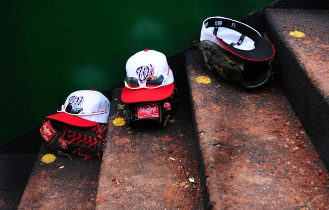 Jul 4, 2013; Washington, DC, USA; Washington Nationals hats sit on the dugout steps during the game against the Milwaukee Brewers at Nationals Park. Mandatory Credit: Evan Habeeb-USA TODAY Sports