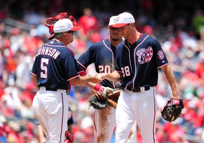 Jul 4, 2013; Washington, DC, USA; Washington Nationals manager Davey Johnson (5) takes the ball from pitcher Taylor Jordan (38) in the sixth inning against the Milwaukee Brewers at Nationals Park. Mandatory Credit: Evan Habeeb-USA TODAY Sports