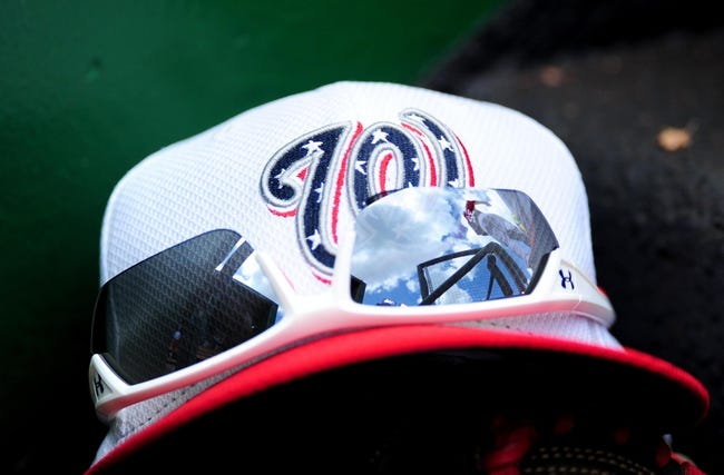 Jul 4, 2013; Washington, DC, USA; A Washington Nationals hat sits on the dugout steps during the game against the Milwaukee Brewers at Nationals Park. Mandatory Credit: Evan Habeeb-USA TODAY Sports
