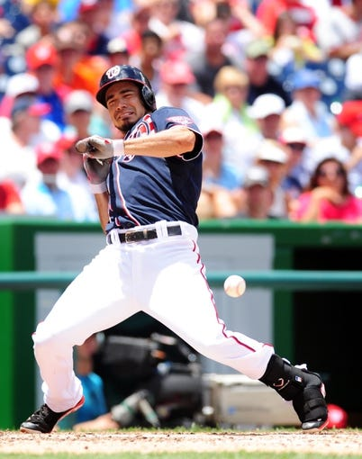 Jul 4, 2013; Washington, DC, USA; Washington Nationals second baseman Anthony Rendon (6) reacts after bunting a ball foul during the game against the Milwaukee Brewers at Nationals Park. Mandatory Credit: Evan Habeeb-USA TODAY Sports