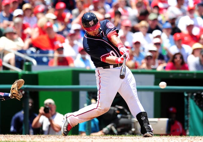 Jul 4, 2013; Washington, DC, USA; Washington Nationals catcher Wilson Ramos (40) hits a two run single in the sixth inning against the Milwaukee Brewers at Nationals Park. Mandatory Credit: Evan Habeeb-USA TODAY Sports