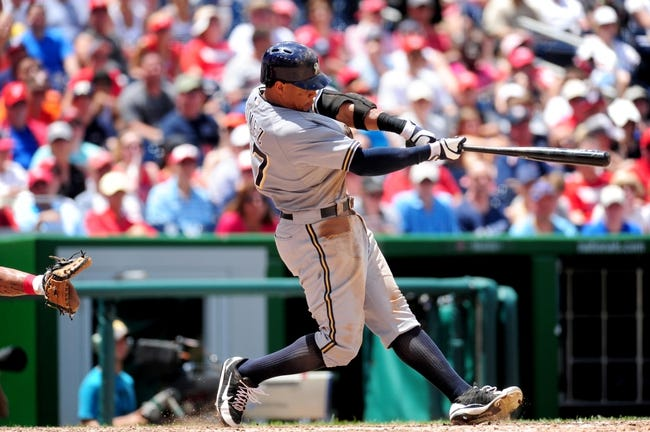 Jul 4, 2013; Washington, DC, USA; Milwaukee Brewers outfielder Carlos Gomez (27) hits a two run home run in the seventh inning against the Washington Nationals at Nationals Park. Mandatory Credit: Evan Habeeb-USA TODAY Sports