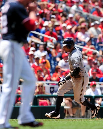 Jul 4, 2013; Washington, DC, USA; Milwaukee Brewers outfielder Carlos Gomez (27) rounds the bases after hitting a two run home run in the seventh inning against the Washington Nationals at Nationals Park. Mandatory Credit: Evan Habeeb-USA TODAY Sports