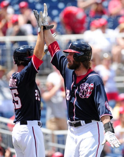 Jul 4, 2013; Washington, DC, USA; Washington Nationals first baseman Adam LaRoche (left) high fives outfielder Jayson Werth (right) after scoring a run in the sixth inning against the Milwaukee Brewers at Nationals Park. Mandatory Credit: Evan Habeeb-USA TODAY Sports