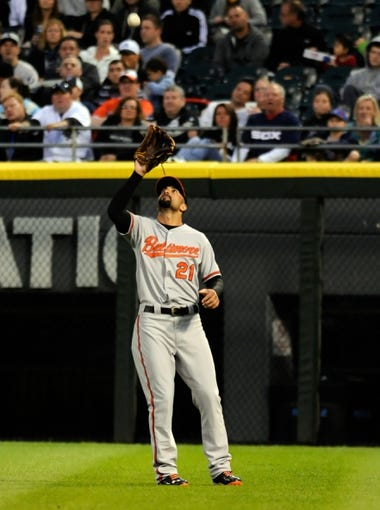 Jul 2, 2013; Chicago, IL, USA; Baltimore Orioles right fielder Nick Markakis (21) makes an out during the fourth inning against the Chicago White Sox at U.S. Cellular Field. Mandatory Credit: Reid Compton-USA TODAY Sports