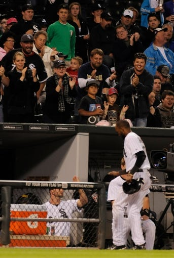 Jul 2, 2013; Chicago, IL, USA; Chicago White Sox shortstop Alexei Ramirez (10) receives a standing ovation from fans after he is tagged out at third base during the seventh inning against the Baltimore Orioles at U.S. Cellular Field. Mandatory Credit: Reid Compton-USA TODAY Sports