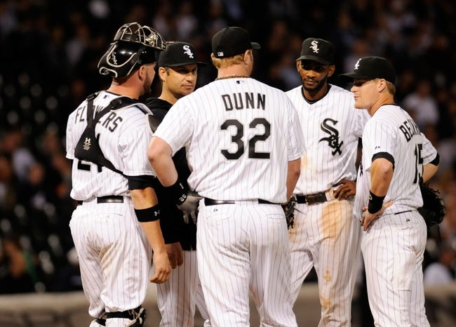 Jul 2, 2013; Chicago, IL, USA; Chicago White Sox manager Robin Ventura (23) talks to catcher Tyler Flowers (21), first baseman Adam Dunn (32), second baseman Gordon Beckham (15) and shortstop Alexei Ramirez (10) during the game against the Baltimore Orioles at U.S. Cellular Field. White Sox defeated the Orioles 5-2. Mandatory Credit: Reid Compton-USA TODAY Sports
