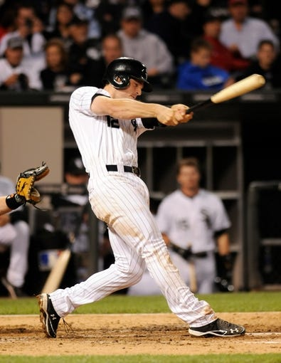 Jul 2, 2013; Chicago, IL, USA; Chicago White Sox third baseman Conor Gillaspie (12) hits a home run during the sixth inning against the Baltimore Orioles at U.S. Cellular Field. Mandatory Credit: Reid Compton-USA TODAY Sports