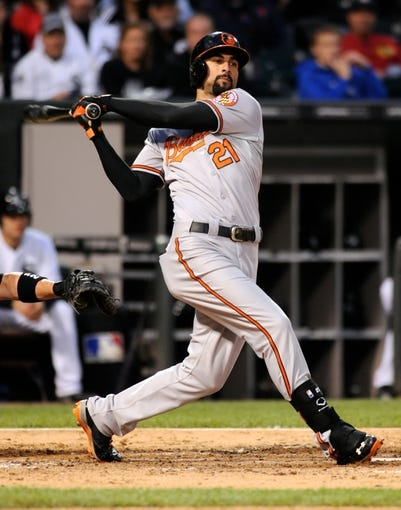 Jul 2, 2013; Chicago, IL, USA; Baltimore Orioles right fielder Nick Markakis (21) singles during the fifth inning against the Chicago White Sox at U.S. Cellular Field. Mandatory Credit: Reid Compton-USA TODAY Sports