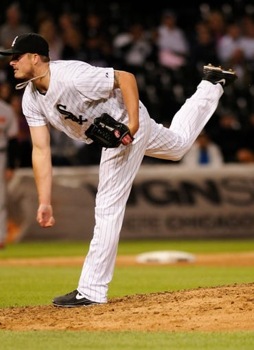 Jul 2, 2013; Chicago, IL, USA; Chicago White Sox relief pitcher Addison Reed (43) delivers a pitch during the ninth inning against the Baltimore Orioles at U.S. Cellular Field. White Sox defeated the Orioles 5-2. Mandatory Credit: Reid Compton-USA TODAY Sports