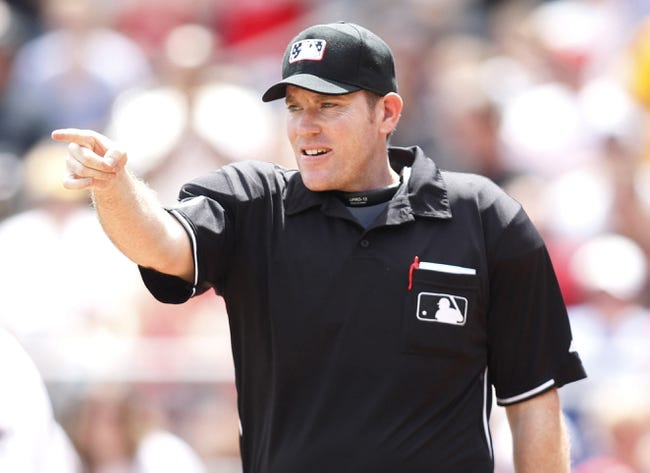 Jul 4, 2013; Pittsburgh, PA, USA; Home plate umpire Chris Conroy gestures on the field during the fifth inning between the Philadelphia Phillies and the Pittsburgh Pirates at PNC Park.The Philadelphia Phillies won 6-4.  Mandatory Credit: Charles LeClaire-USA TODAY Sports