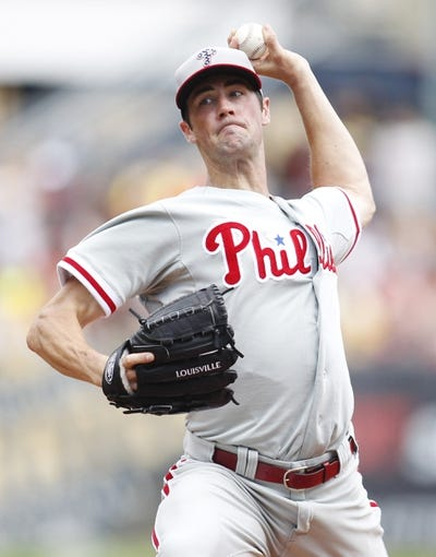 Jul 4, 2013; Pittsburgh, PA, USA; Philadelphia Phillies starting pitcher Cole Hamels (35) pitches against the Pittsburgh Pirates during the fifth inning at PNC Park. The Philadelphia Phillies won 6-4. Mandatory Credit: Charles LeClaire-USA TODAY Sports