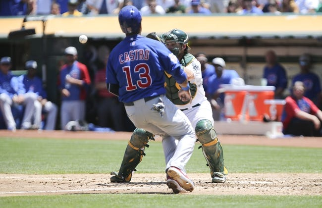 Jul 4, 2013; Oakland, CA, USA; Oakland Athletics catcher Derek Norris (36) catches the ball to tag Chicago Cubs shortstop Starlin Castro (13) out at home during the fourth inning at O.co Coliseum. Mandatory Credit: Kelley L Cox-USA TODAY Sports