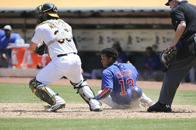Jul 4, 2013; Oakland, CA, USA; Oakland Athletics catcher Derek Norris (36) tags out Chicago Cubs shortstop Starlin Castro (13) at home during the fourth inning at O.co Coliseum. Mandatory Credit: Kelley L Cox-USA TODAY Sports