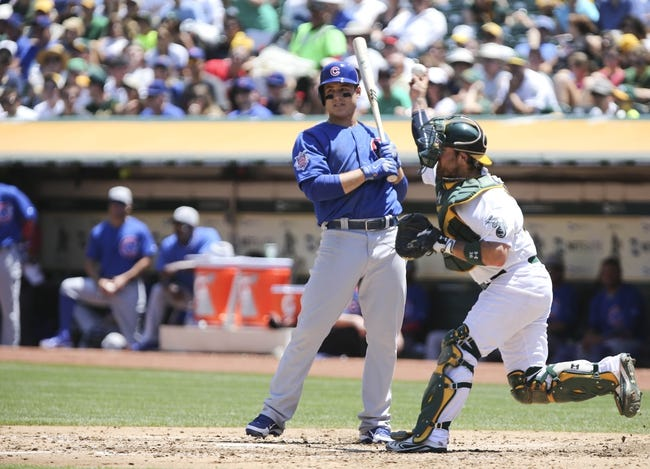 Jul 4, 2013; Oakland, CA, USA; Oakland Athletics catcher Derek Norris (right) throws the ball to catch the runner stealing second base against the Chicago Cubs during the fourth inning at O.co Coliseum. Mandatory Credit: Kelley L Cox-USA TODAY Sports
