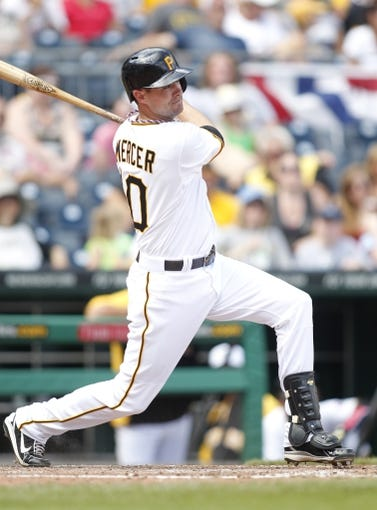 Jul 4, 2013; Pittsburgh, PA, USA; Pittsburgh Pirates shortstop Jordy Mercer (10) singles against the Philadelphia Phillies during the eighth inning at PNC Park. The Philadelphia Phillies won 6-4. Mandatory Credit: Charles LeClaire-USA TODAY Sports