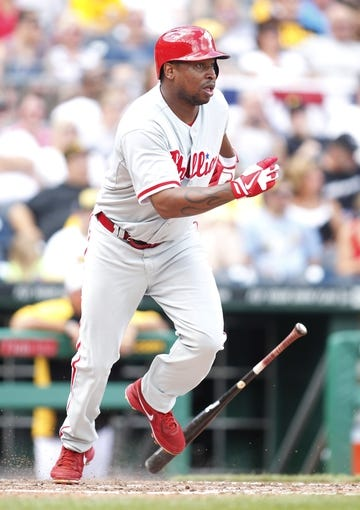 Jul 4, 2013; Pittsburgh, PA, USA; Philadelphia Phillies right fielder Delmon Young (3) singles against the Pittsburgh Pirates during the eighth inning at PNC Park. The Philadelphia Phillies won 6-4. Mandatory Credit: Charles LeClaire-USA TODAY Sports