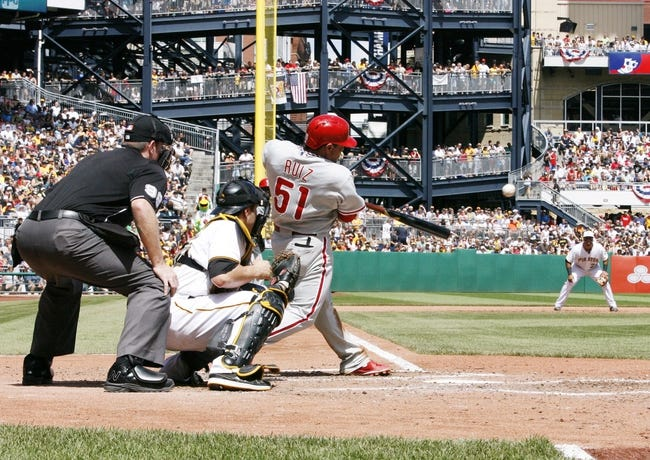 Jul 4, 2013; Pittsburgh, PA, USA; Philadelphia Phillies catcher Carlos Ruiz (51) hits a two RBI single against the Pittsburgh Pirates during the sixth inning at PNC Park. The Philadelphia Phillies won 6-4. Mandatory Credit: Charles LeClaire-USA TODAY Sports