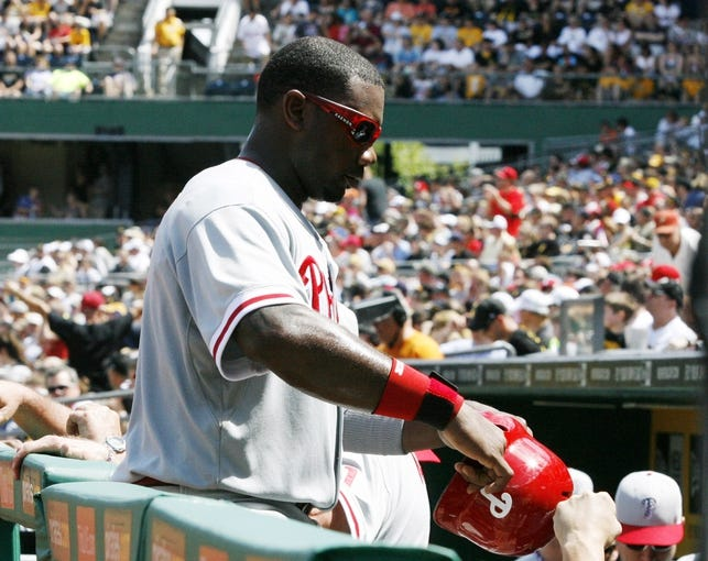 Jul 4, 2013; Pittsburgh, PA, USA; Philadelphia Phillies first baseman Ryan Howard (6) is greeted at the dugout after scoring a run against the Pittsburgh Pirates during the sixth inning at PNC Park. The Philadelphia Phillies won 6-4. Mandatory Credit: Charles LeClaire-USA TODAY Sports