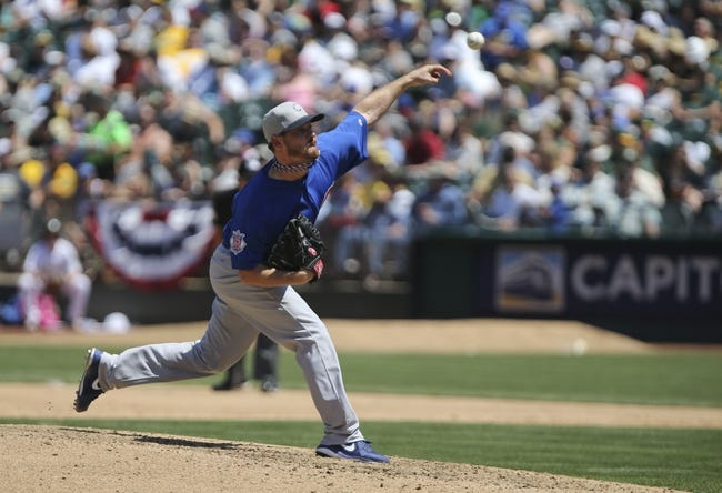 Jul 4, 2013; Oakland, CA, USA; Chicago Cubs starting pitcher Travis Wood (37) pitches the ball against the Oakland Athletics during the sixth inning at O.co Coliseum. Mandatory Credit: Kelley L Cox-USA TODAY Sports