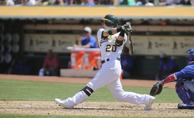 Jul 4, 2013; Oakland, CA, USA; Oakland Athletics third baseman Josh Donaldson (20) hits a single to advance a runner against the Chicago Cubs during the sixth inning at O.co Coliseum. Mandatory Credit: Kelley L Cox-USA TODAY Sports