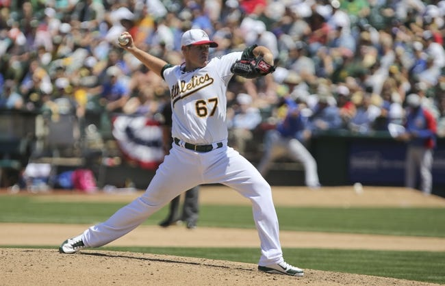 Jul 4, 2013; Oakland, CA, USA; Oakland Athletics starting pitcher Dan Straily (67) pitches the ball against the Chicago Cubs during the seventh inning at O.co Coliseum. Mandatory Credit: Kelley L Cox-USA TODAY Sports