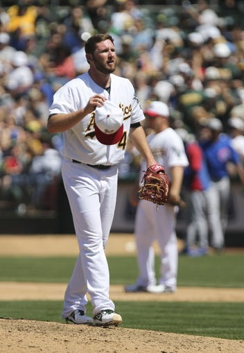 Jul 4, 2013; Oakland, CA, USA; Oakland Athletics relief pitcher Ryan Cook (48) reacts after catching a ball off the bat for an out against the Chicago Cubs during the eighth inning at O.co Coliseum. The Oakland Athletics defeated the Chicago Cubs 1-0. Mandatory Credit: Kelley L Cox-USA TODAY Sports