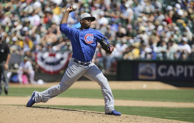 Jul 4, 2013; Oakland, CA, USA; Chicago Cubs relief pitcher Pedro Strop (46) pitches the ball against the Oakland Athletics during the eighth inning at O.co Coliseum. The Oakland Athletics defeated the Chicago Cubs 1-0. Mandatory Credit: Kelley L Cox-USA TODAY Sports