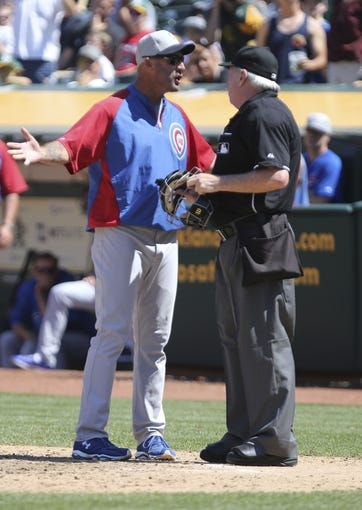 Jul 4, 2013; Oakland, CA, USA; Chicago Cubs manager Dale Sveum (left) argues with umpire Brian Gorman (9) during the eighth inning against the Oakland Athletics at O.co Coliseum. The Oakland Athletics defeated the Chicago Cubs 1-0. Mandatory Credit: Kelley L Cox-USA TODAY Sports