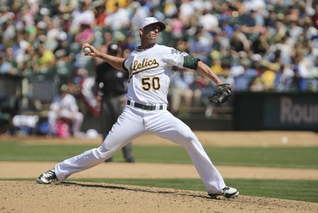 Jul 4, 2013; Oakland, CA, USA; Oakland Athletics relief pitcher Grant Balfour (50) pitches the ball against the Chicago Cubs during the ninth inning at O.co Coliseum. The Oakland Athletics defeated the Chicago Cubs 1-0. Mandatory Credit: Kelley L Cox-USA TODAY Sports