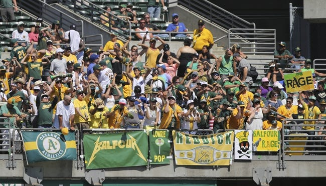 Jul 4, 2013; Oakland, CA, USA; Oakland Athletics fans perform the Balfour rage for relief pitcher Grant Balfour (not pictured) during the ninth inning against the Chicago Cubs at O.co Coliseum. The Oakland Athletics defeated the Chicago Cubs 1-0. Mandatory Credit: Kelley L Cox-USA TODAY Sports