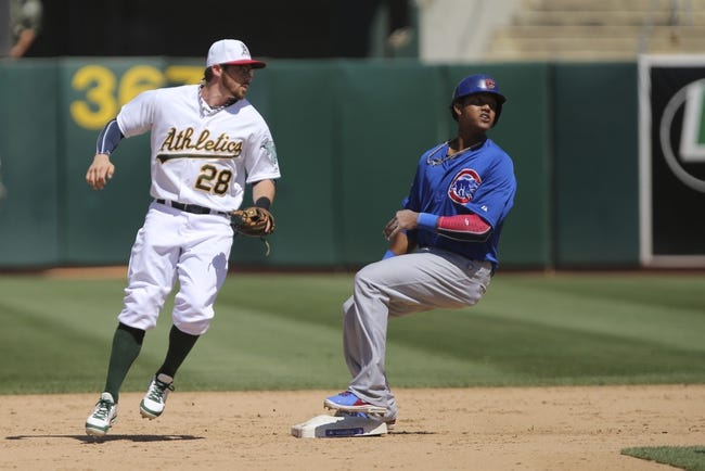 Jul 4, 2013; Oakland, CA, USA; Chicago Cubs shortstop Starlin Castro (13) reaches second base uncontested against Oakland Athletics second baseman Eric Sogard (28) during the ninth inning at O.co Coliseum. The Oakland Athletics defeated the Chicago Cubs 1-0. Mandatory Credit: Kelley L Cox-USA TODAY Sports