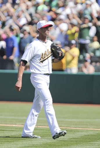 Jul 4, 2013; Oakland, CA, USA; Oakland Athletics relief pitcher Grant Balfour (50) after the win over the Chicago Cubs at O.co Coliseum. The Oakland Athletics defeated the Chicago Cubs 1-0. Mandatory Credit: Kelley L Cox-USA TODAY Sports